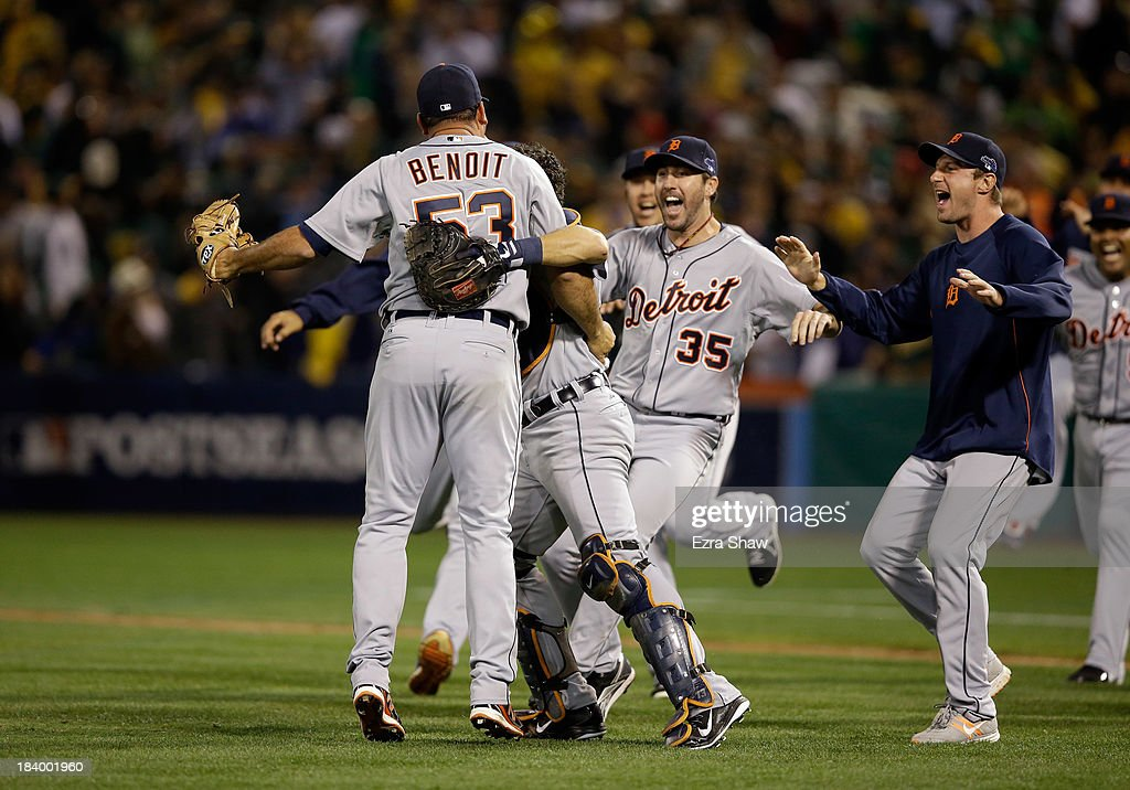 Joaquin Benoit #53 of the Detroit Tigers is congratulated by teammates including <a gi-track='captionPersonalityLinkClicked' href=/galleries/search?phrase=Justin+Verlander&family=editorial&specificpeople=556723 ng-click='$event.stopPropagation()'>Justin Verlander</a> #35 after they beat the Oakland Athletics in Game Five of the American League Division Series at O.co Coliseum on October 10, 2013 in Oakland, California.
