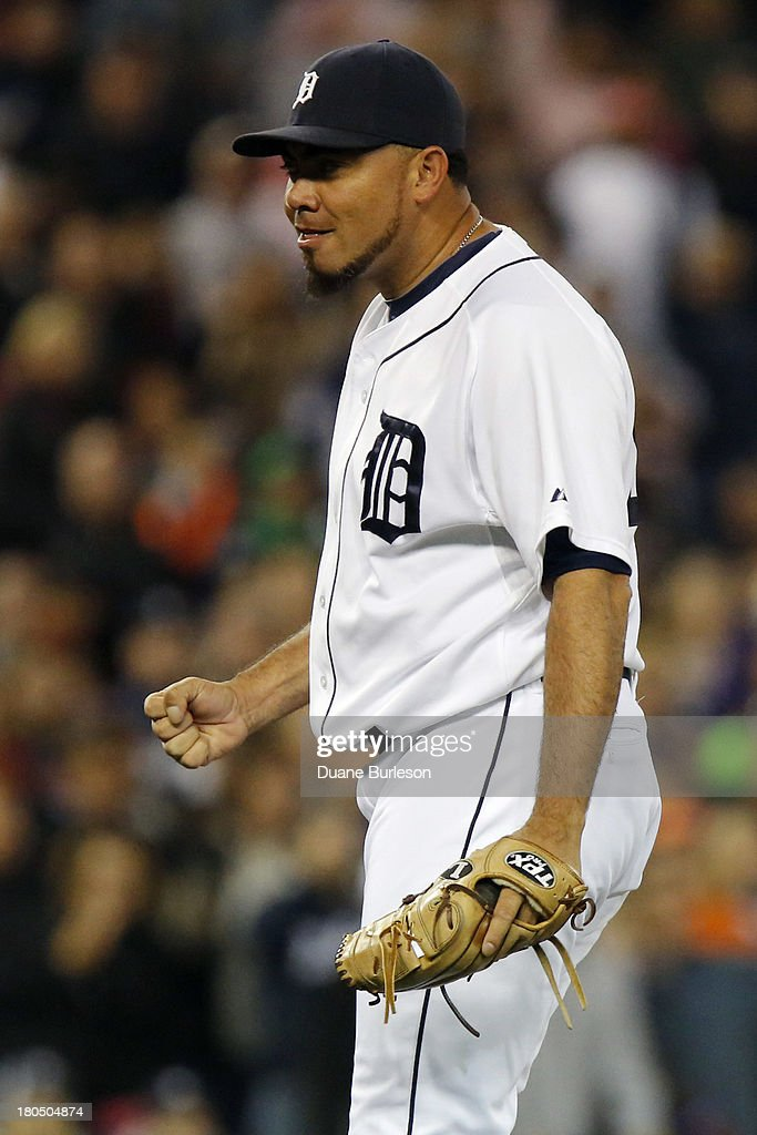 Joaquin Benoit #53 of the Detroit Tigers pumps his fist after getting the final out against the Kansas City Royals in the ninth inning for his 19th save at Comerica Park on September 13, 2013 in Detroit, Michigan.