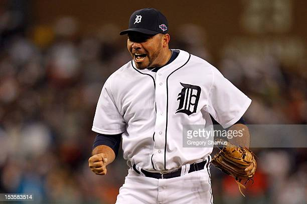 Joaquin Benoit of the Detroit Tigers reacts as he pitches in the eighth inning against the Oakland Athletics during Game One of the American League...
