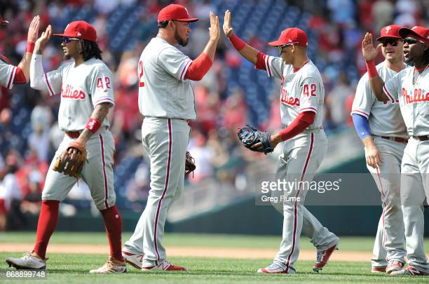 Joaquin Benoit of the Philadelphia Phillies celebrates with Cesar Hernandez after a 42 victory against the Washington Nationals at Nationals Park on...