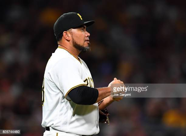 Joaquin Benoit of the Pittsburgh Pirates reacts after giving up a solo home run to Jesse Winker of the Cincinnati Reds during the seventh inning...