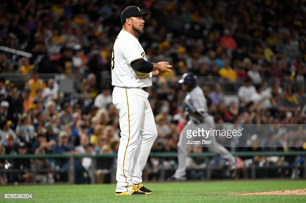 Joaquin Benoit of the Pittsburgh Pirates reacts as Manuel Margot of the San Diego Padres rounds the bases after hitting a solo home run to center...