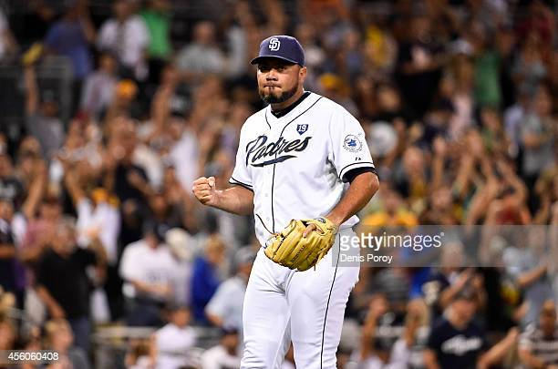 Joaquin Benoit of the San Diego Padres pumps his fist after getting the final out during the ninth inning of a baseball game against the Colorado...