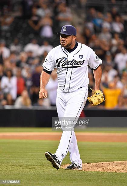 Joaquin Benoit of the San Diego Padres reacts while pitching during a baseball game against the Colorado Rockies at Petco Park August 11 2014 in San...