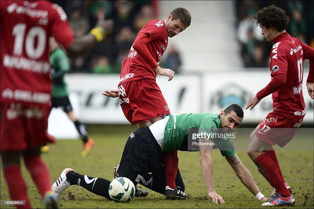 Joaquin Boghossian of Cercle Brugge battles for the ball with Nebosja Pavlovic of KV Kortrijk during the Cofidis Cup semi-final match between KV Kortrijk and Cercle Brugge in the Guldensporen stadium on March 03, 2013 in Kortrijk, Belgium.