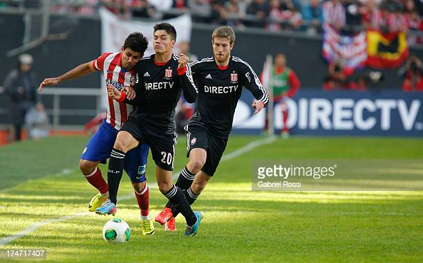 Joaquin Correa of Estudiantes and Diego da Silva Costa of Atletico de Madrid fight for the ball during a match between Estudiantes and Atletico de...