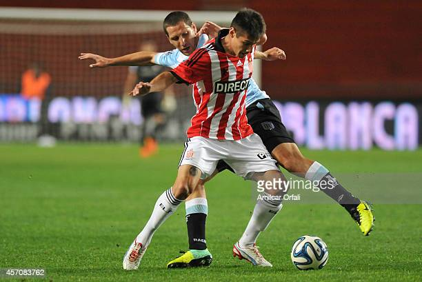 Joaquin Correa of Estudiantes and Mauricio Lollo of Racing Club fight for the ball during a match between Estudiantes and Racing Club as part of...