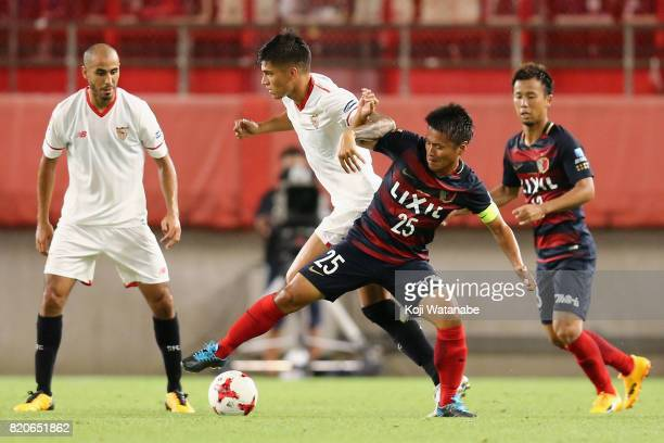 Joaquin Correa of Sevilla and Yasushi Endo of Kashima Antlers compete for the ball during the preseason friendly match between Kashima Antlers and...