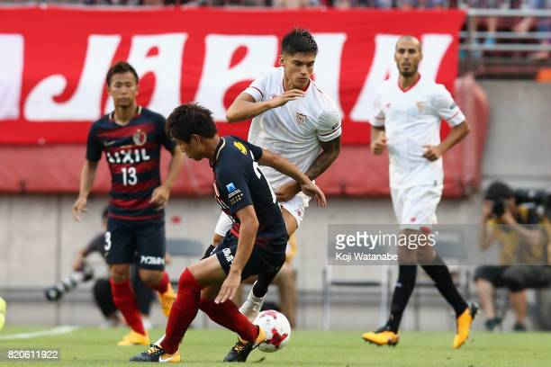 Joaquin Correa of Sevilla and Yukitoshi Ito of Kashima Antlers compete for the ball during the preseason friendly match between Kashima Antlers and...