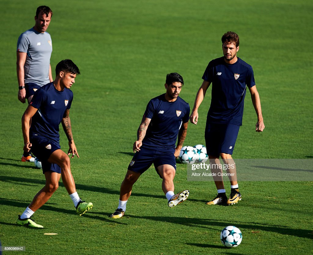Joaquin Correa of Sevilla FC (L) and Ever Banega of Sevilla FC (C) in action during the training session prior to their UEFA Champions League match against Istanbul Basaksehir at the Sevilla FC training ground on August 21, 2017 in Seville, Spain.