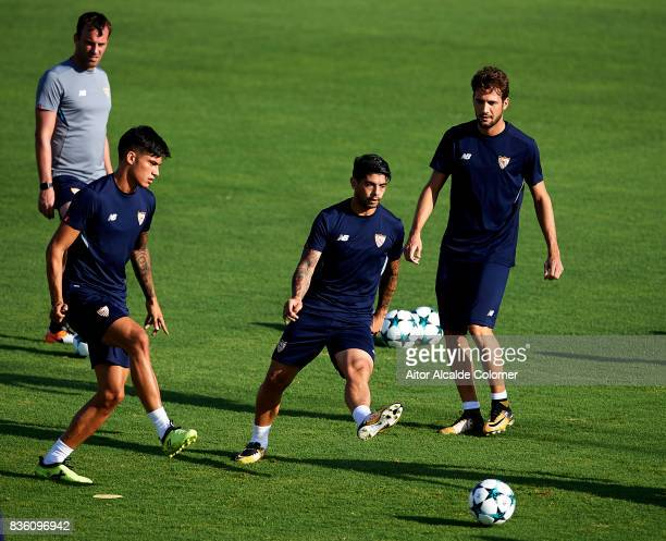 Joaquin Correa of Sevilla FC and Ever Banega of Sevilla FC in action during the training session prior to their UEFA Champions League match against...