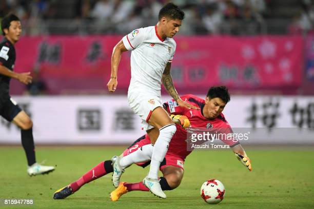 Joaquin Correa of Sevilla FC and Kim Jinhyeon of Cerezo Osaka in action during the preseason friendly match between Cerezo Osaka and Sevilla FC at...