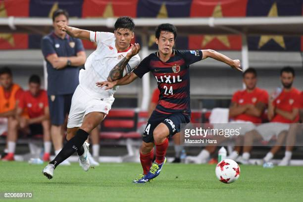 Joaquin Correa of Sevilla FC and Toshiyuki Ito of kashima Antlers compete for the ball during the preseason friendly match between Kashima Antlers...