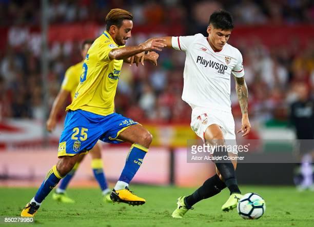 Joaquin Correa of Sevilla FC being followed by Alberto Aquilani of Union Deportiva Las Palmas during the La Liga match between Sevilla and Las Palmas...