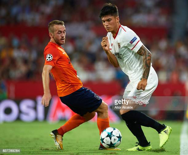 Joaquin Correa of Sevilla FC being followed by Edin Visca of Istanbul Basaksehir during the UEFA Champions League Qualifying PlayOffs round second...