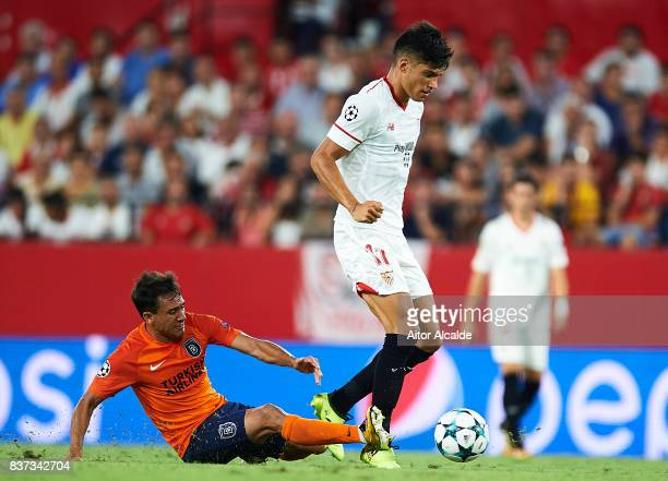 Joaquin Correa of Sevilla FC being fouled by Mossoro of Istanbul Basaksehir during the UEFA Champions League Qualifying PlayOffs round second leg...
