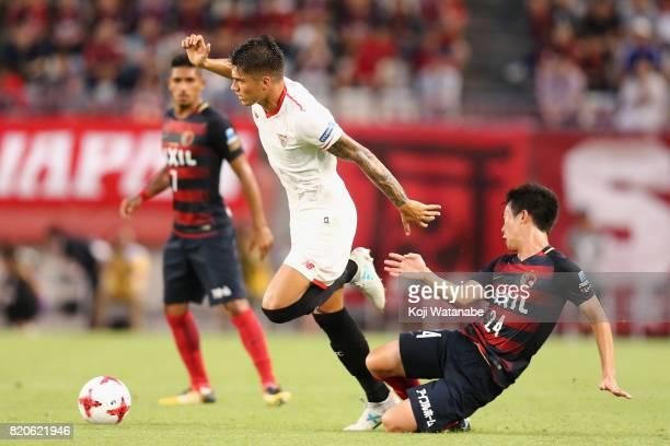 Joaquin Correa of Sevilla is tackled by Yukitoshi Ito of Kashima Antlers during the preseason friendly match between Kashima Antlers and Sevilla FC...