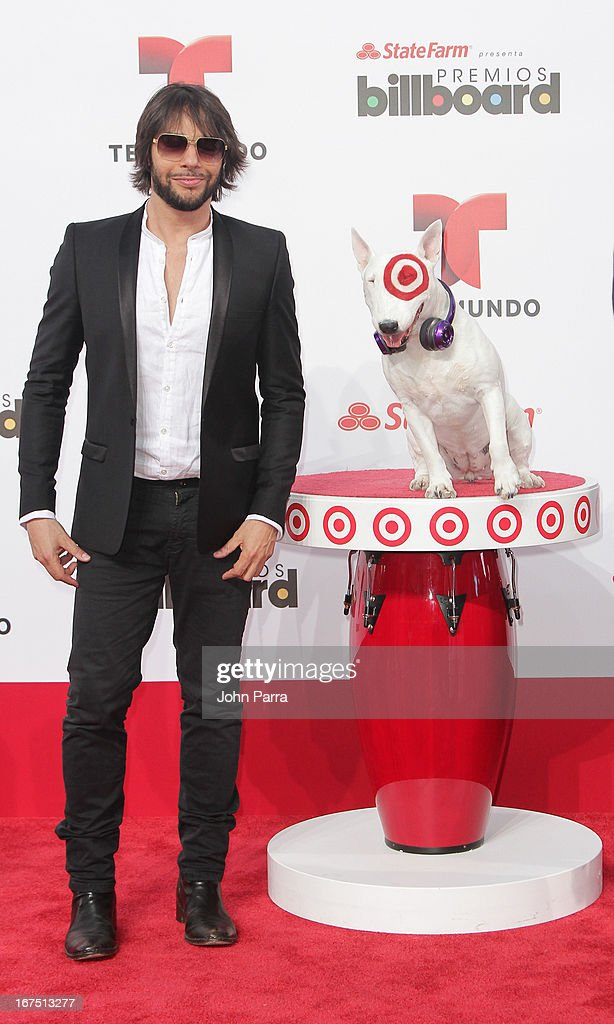 Joaquin Cortes celebrates with Bullseye, Target's Beloved Bull Terrier Mascot, at the 2013 Billboard Latin Music Awards at BankUnited Center on April 25, 2013 in Miami, Florida.