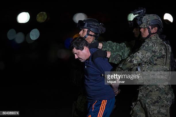 Joaquin 'El Chapo' Guzman is escorted after President of Mexico Enrique Pe–na Nieto announced his detention on January 08 2016 in Mexico City Mexico...