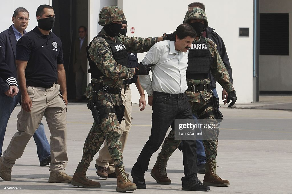 Joaquin 'El Chapo' Guzman is escorted to a helicopter in handcuffs by Mexican navy marines at a navy hanger. Guzman leader of Mexico's Sinaloa drug Cartel, was captured alive overnight in the beach resort town of Mazatlan, considered the Mexican most-wanted drug dealer on February 22, 2014 in Mexico City, Mexico.
