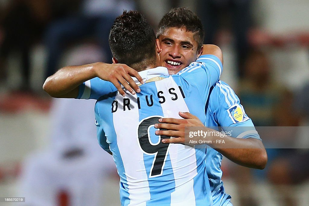 Joaquin Ibanez (back) celebrates his team's first goal with team mate Sebastian Driussi during the FIFA U-17 World Cup UAE 2013 Group E match between Argentina and Austria at Al Rashid Stadium on October 22, 2013 in Dubai, United Arab Emirates.