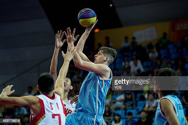 Joaquin Jones of Uruguay shoots the ball against players of China in the Men's 3x3 Basketball Preliminary Round Pool A match on day two of the...