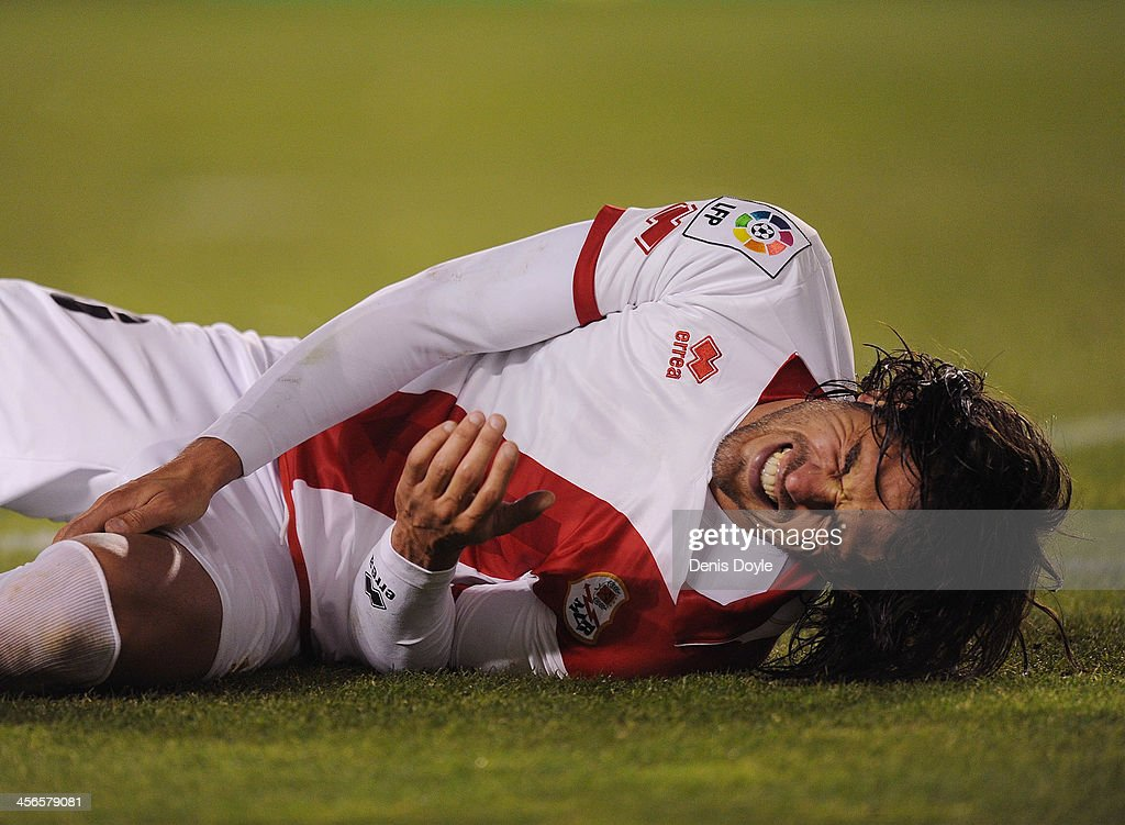 Joaquin Larrivey of Rayo Vallecano de Madrid reacts in pain after taking a knock during the La Liga match between Rayo Vallecano de Madrid and Granada CF at Teresa Rivero stadium on December 14, 2013 in Madrid, Spain.