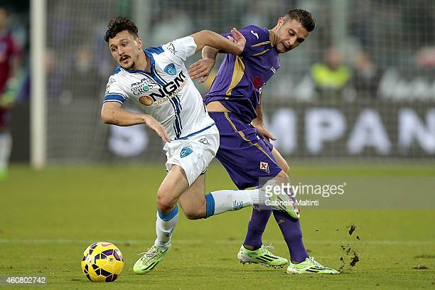Joaquin of ACF Fiorentina battles for the ball with Mario Rui of Empoli FC during the Serie A match betweeen ACF Fiorentina and Empoli FC at Stadio...