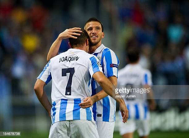 Joaquin of Malaga CF celebrates scoring his sides opening goal with his teammate Ignacio Camacho during the UEFA Champions League group C match...
