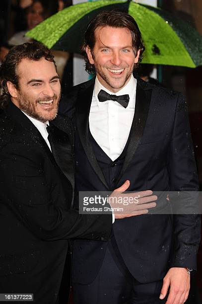 Joaquin Phoenix and Bradley Cooper attend the EE British Academy Film Awards at The Royal Opera House on February 10 2013 in London England