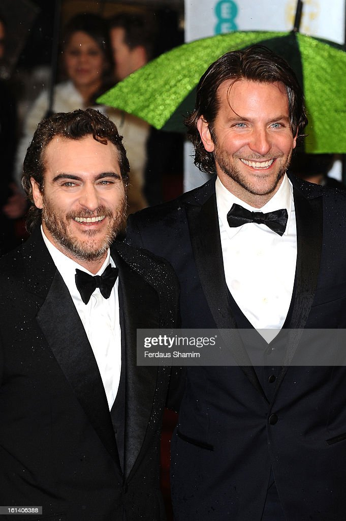 Joaquin Phoenix and Bradley Cooper attend the EE British Academy Film Awards at The Royal Opera House on February 10, 2013 in London, England.