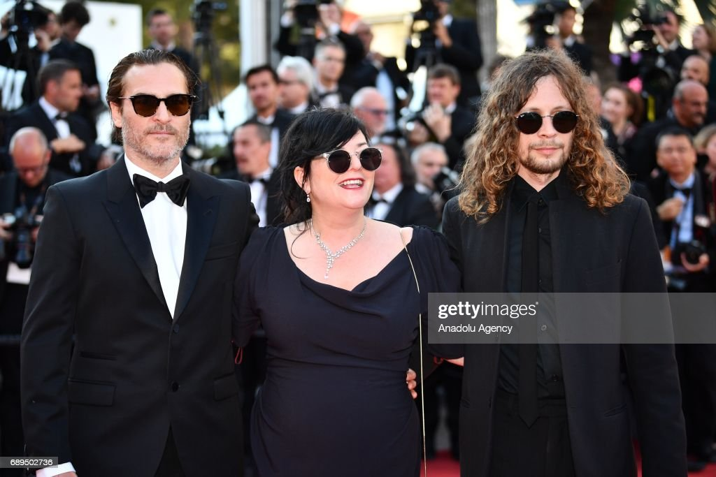 Joaquin Phoenix (L) and director Lynne Ramsay (C) arrive for the Closing Awards Ceremony of the 70th annual Cannes Film Festival in Cannes, France on May 28, 2017.