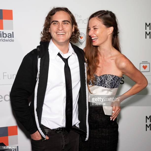 Joaquin Phoenix and the Lunchbox Fund founder and executive director Topaz PageGreen attend the Lunchbox Fund Fall Fete 2013 at Buddakan on October 9...