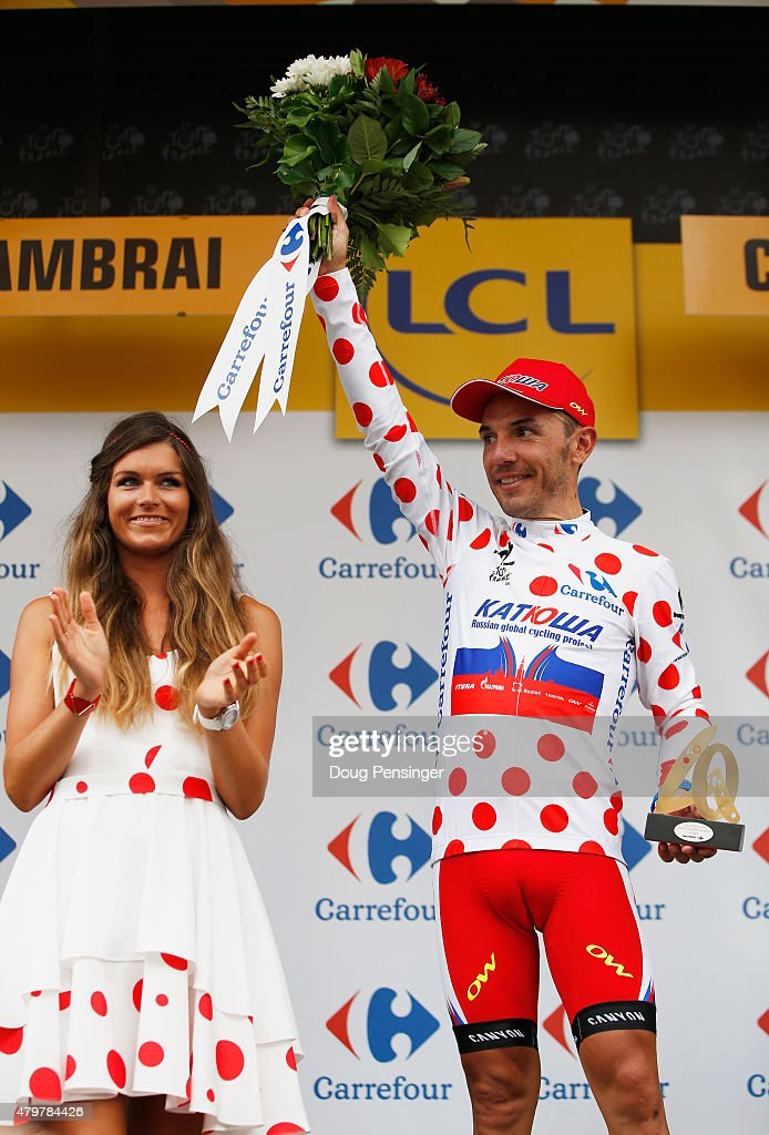 Joaquin Rodriguez Oliver of Spain and Team Katusha celebrates as he is awarded the polka-dot jersey on the podium after stage four of the 2015 Tour de France, a 223.5km stage between Seraing and Cambrai, on July 7, 2015 in Cambrai, France.