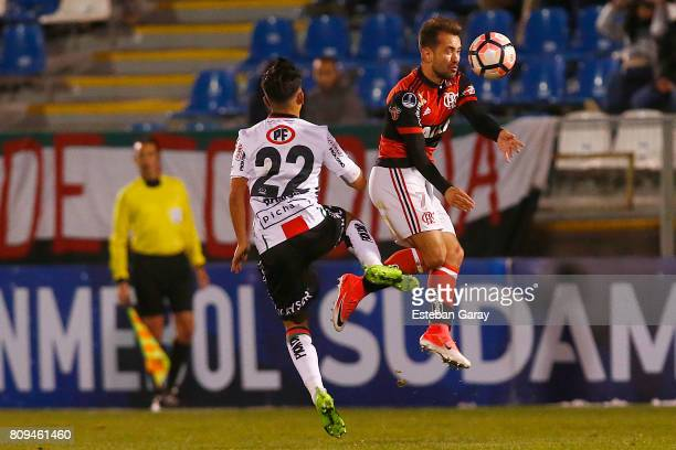 Joaquin Romo of Palestino fights for the ball with Everton Ribeiro of Flamengo during a match between Palestino and Flamengo as part of the second...