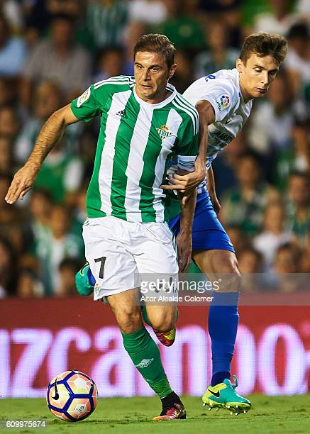 Joaquin Sanchez of Real Betis Balompie competes for the ball with Diego Llorente of Malaga CF during the match between Real Betis Balompie vs Malaga...