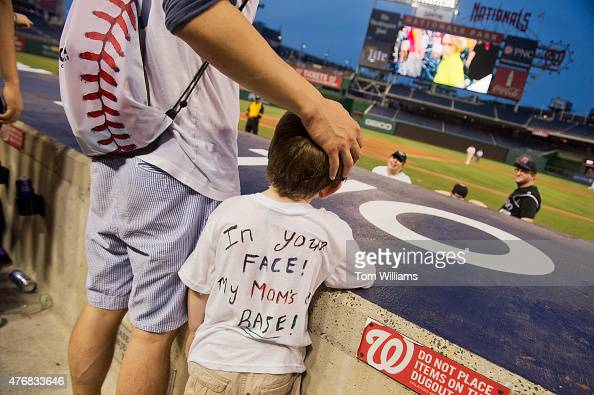 Joaquin Sanchez Sullivan son of Rep Linda Sanchez DCalif center attends the 54th Congressional Baseball Game in Nationals Park June 11 2014 The...