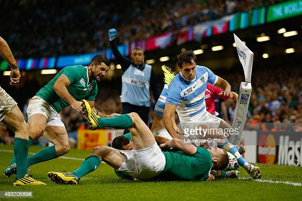 Joaquin Tuculet of Argentina rolls over to score his team's third try during the 2015 Rugby World Cup Quarter Final match between Ireland and...