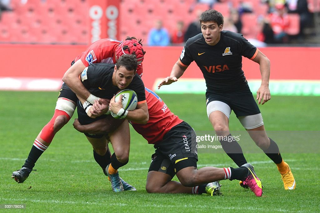 Joaquin Tuculet of the Jaguares tackled by Warren Whiteley of the Lions during the Super Rugby match between Emirates Lions and Jaguares at Emirates Airline Park on May 21, 2016 in Johannesburg, South Africa.