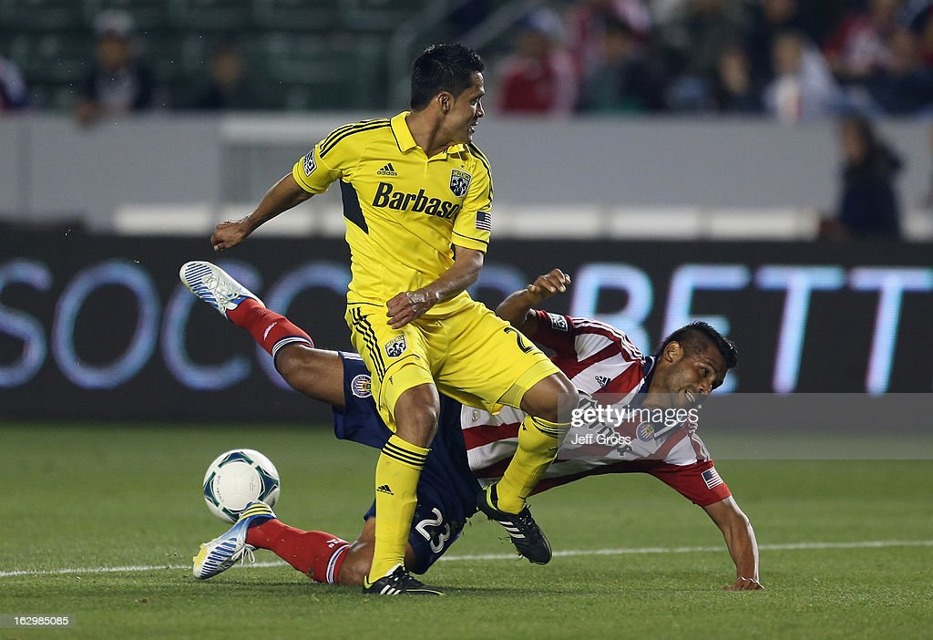 Joaquin Velasquez #23 of Chivas USA falls while pursuing the ball with Jairo Arrieta #25 of Columbus Crew in the first half at The Home Depot Center on March 2, 2013 in Carson, California.