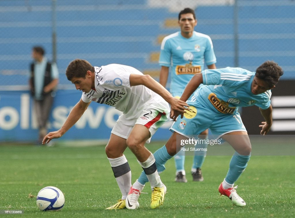 Joarzinho Arroe of Sporting Cristal fights for the ball with Aldo Corzo of San Martin during a match between Sporting Cristal and San Martin as part of The 2013 Torneo Descentralizado at the Alberto Gallardo Stadium on February 09, 2013 in Lima, Peru
