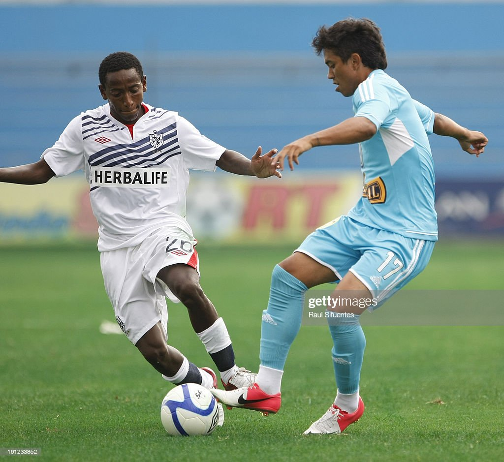 Joarzinho Arroe of Sporting Cristal fights for the ball with Jack Duran of San Martin during a match between Sporting Cristal and San Martin as part of The 2013 Torneo Descentralizado at the Alberto Gallardo Stadium on February 09, 2013 in Lima, Peru