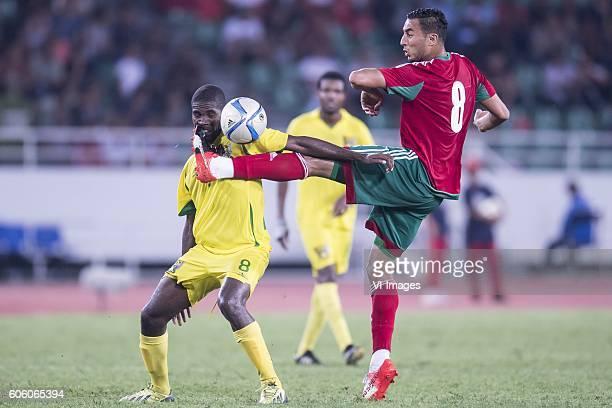 Joazhifel Soares da Cruz Soua Pontes of Sao Tome e Principe Aziz Bouhaddouz of Morocco during the Africa Cup of Nations match between Morocco and Sao...