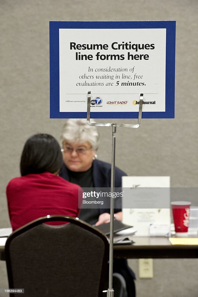 A job applicant, front, listens to Linda Hamilton during a resume review during a HIREvent job fair in Concord, California, U.S., on Tuesday, Nov. 13, 2012. The U.S. Labor Department is scheduled to release initial jobless claims and continuing claims data on Nov. 15 Photographer: David Paul Morris/Bloomberg via Getty Images