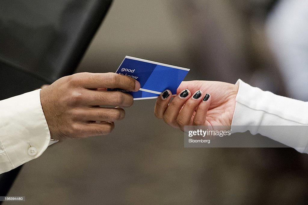 A job applicant, left, receives a business card from Roshni Bhatt, staffing consultant for Randstad Holding N.V., during a HIREvent job fair in Concord, California, U.S., on Tuesday, Nov. 13, 2012. The U.S. Labor Department is scheduled to release initial jobless claims and continuing claims data on Nov. 15 Photographer: David Paul Morris/Bloomberg via Getty Images