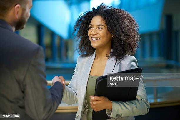 job applicant shaking hands .