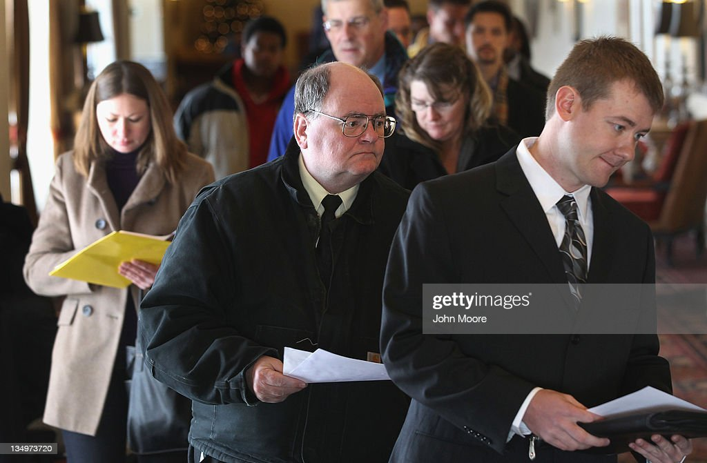 Job applicants enter the 'Denver Hires Job Fair' on December 5, 2011 in Denver, Colorado. Last week the U.S. government announced that the national unemployment rate has fallen to 8.6 percent, lower than most analysts had predicted and the lowest since 2009.