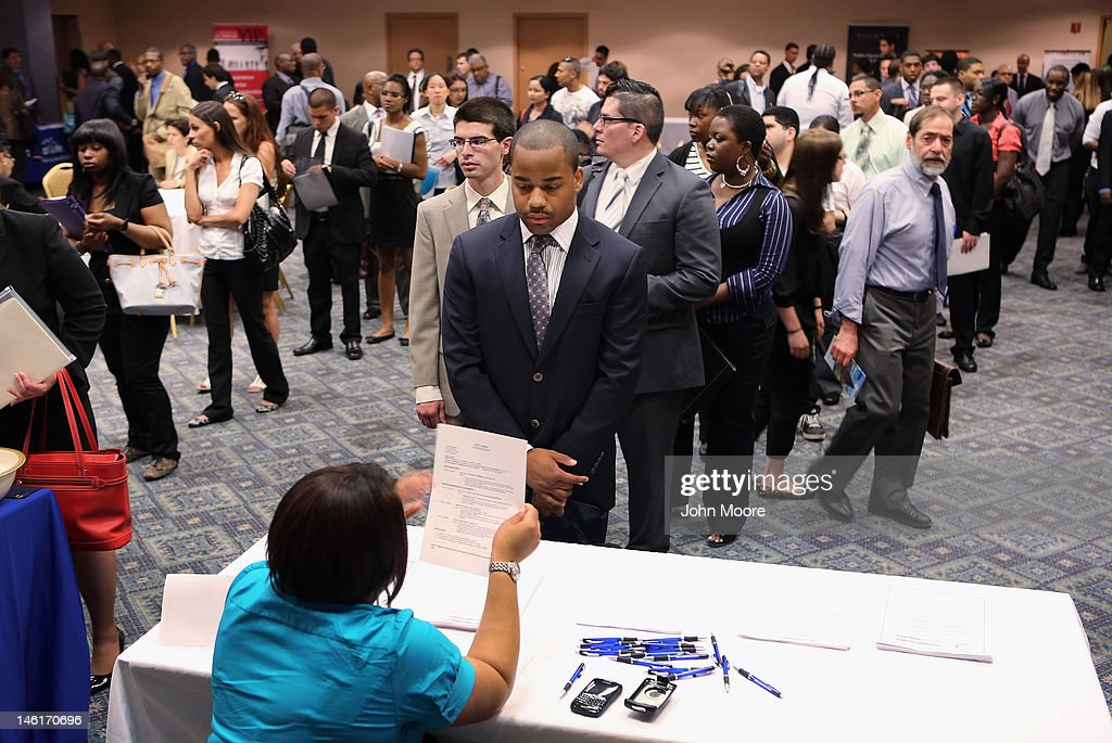 Job applicants line up to meet potential employers at a job fair on June 11, 2012 in New York City. Some 400 arrived early for the event held by National Career Fairs, and up to 1,000 people were expected by the end of the day.