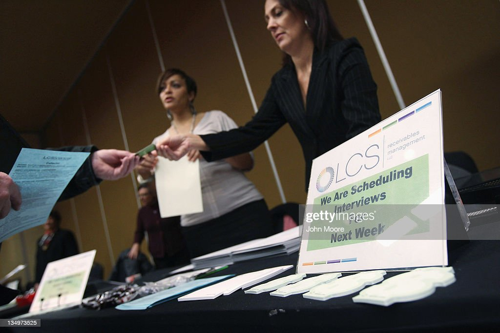 Job applicants meet potential employers at the 'Denver Hires Job Fair' on December 5, 2011 in Denver, Colorado. Last week the U.S. government announced that the national unemployment rate has fallen to 8.6 percent, lower than most analysts had predicted and the lowest since 2009.