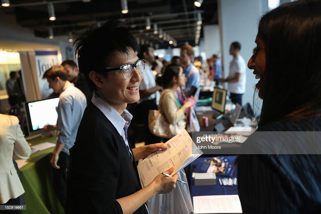 Job applicants meet potential employers at the NYC Startup Job Fair held at 7 World Trade Center on September 28, 2012 in New York City. More than 80 startup companies were represented, with some 600 job openings for the more than 1,000 applicants who attended the event.